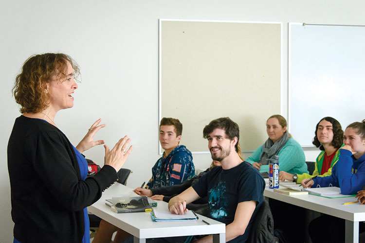 photo of Dr. Joanne Murphy teaching undergraduate students in a classroom