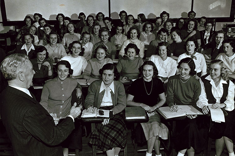 a 1951 photo of former chancellor, Walter C. Jackson, teaching a history class