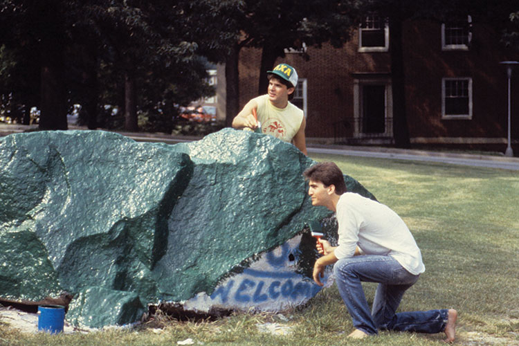 photo of two students painting the