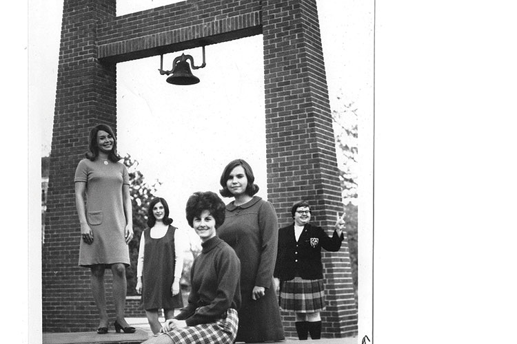 vintage photo of the University Bell, showing several students in front