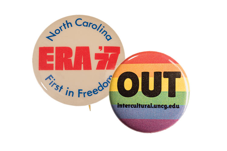 photo of buttons for advocacy, women's rights (left), and LGBTQ (right)