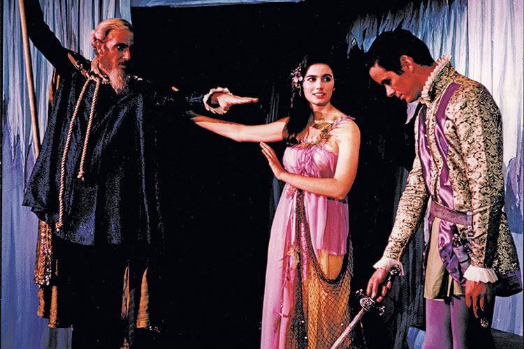 "photo Emmylou Harris and 2 cast members on stage in ""The Tempest"