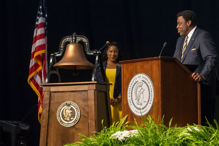 photo of the newly refurbished University Bell at August's NAV1GATE convocation with Chancellor Gilliam delivering a speech