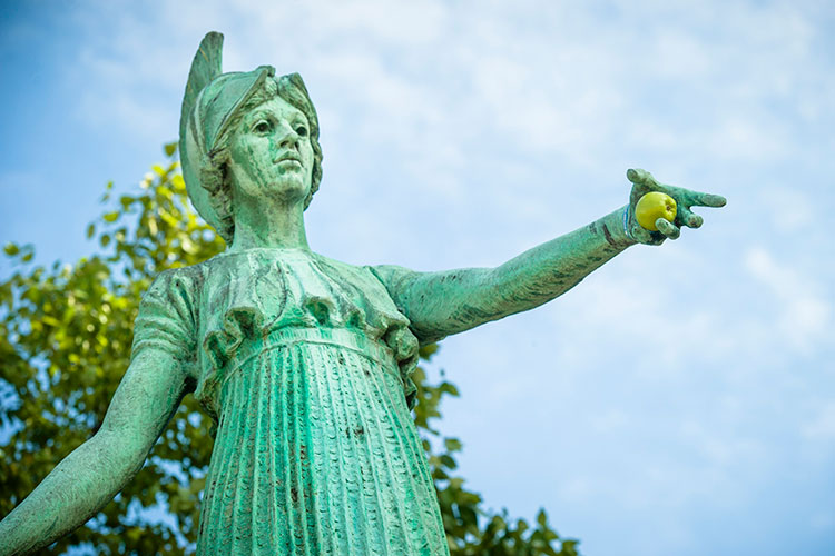 photo of Minerva statue holding an apple