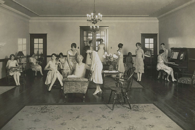 photo of students gathered in a Parlor in the late 1920s