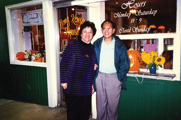 photo of Hong Kong House owners Amelia and Robert Leung in front of their restaurant