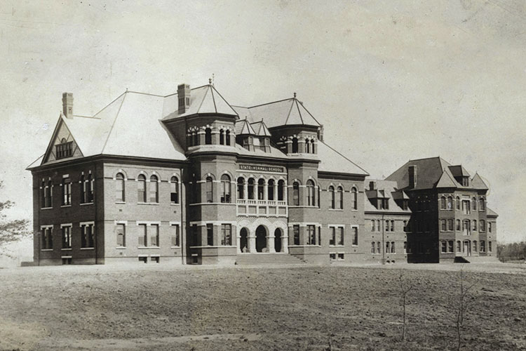 a vintage photo of the Foust Building, the campus' first building